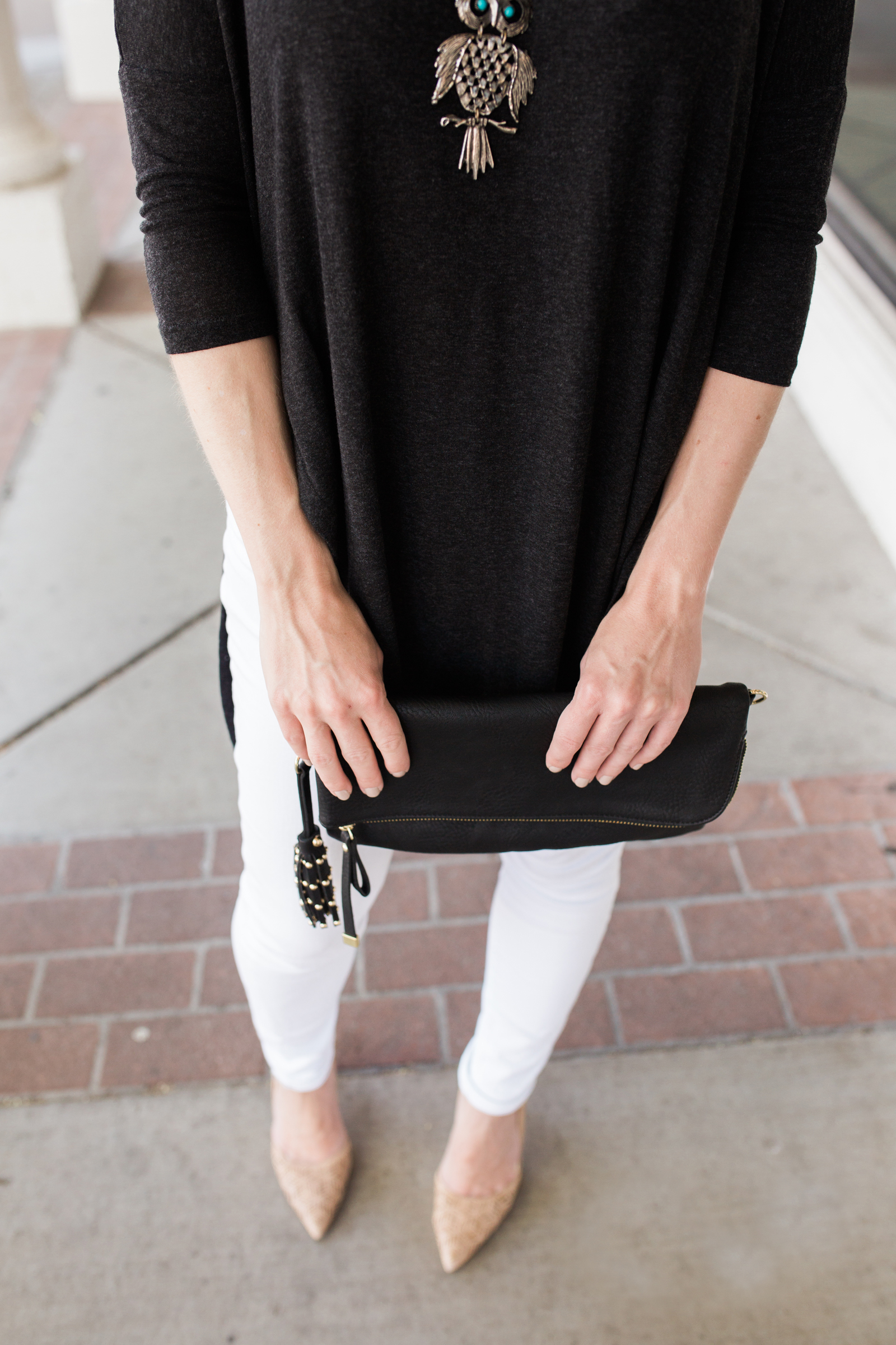 Gray Tunic and Black Clutch