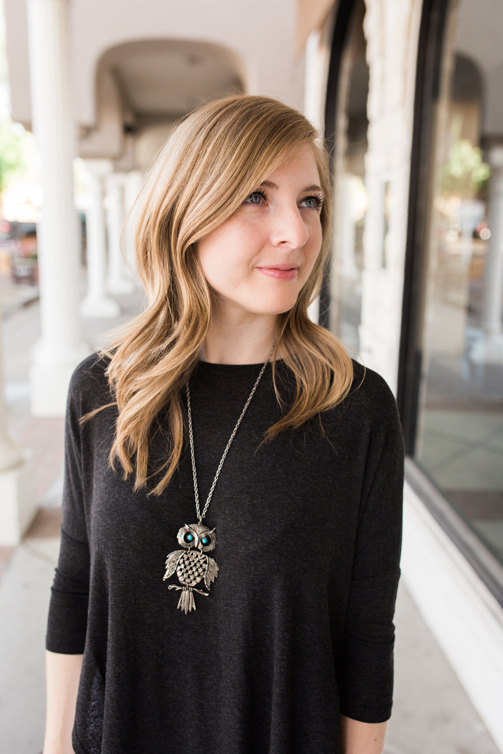 Vintage Owl Necklace against a Black Tunic