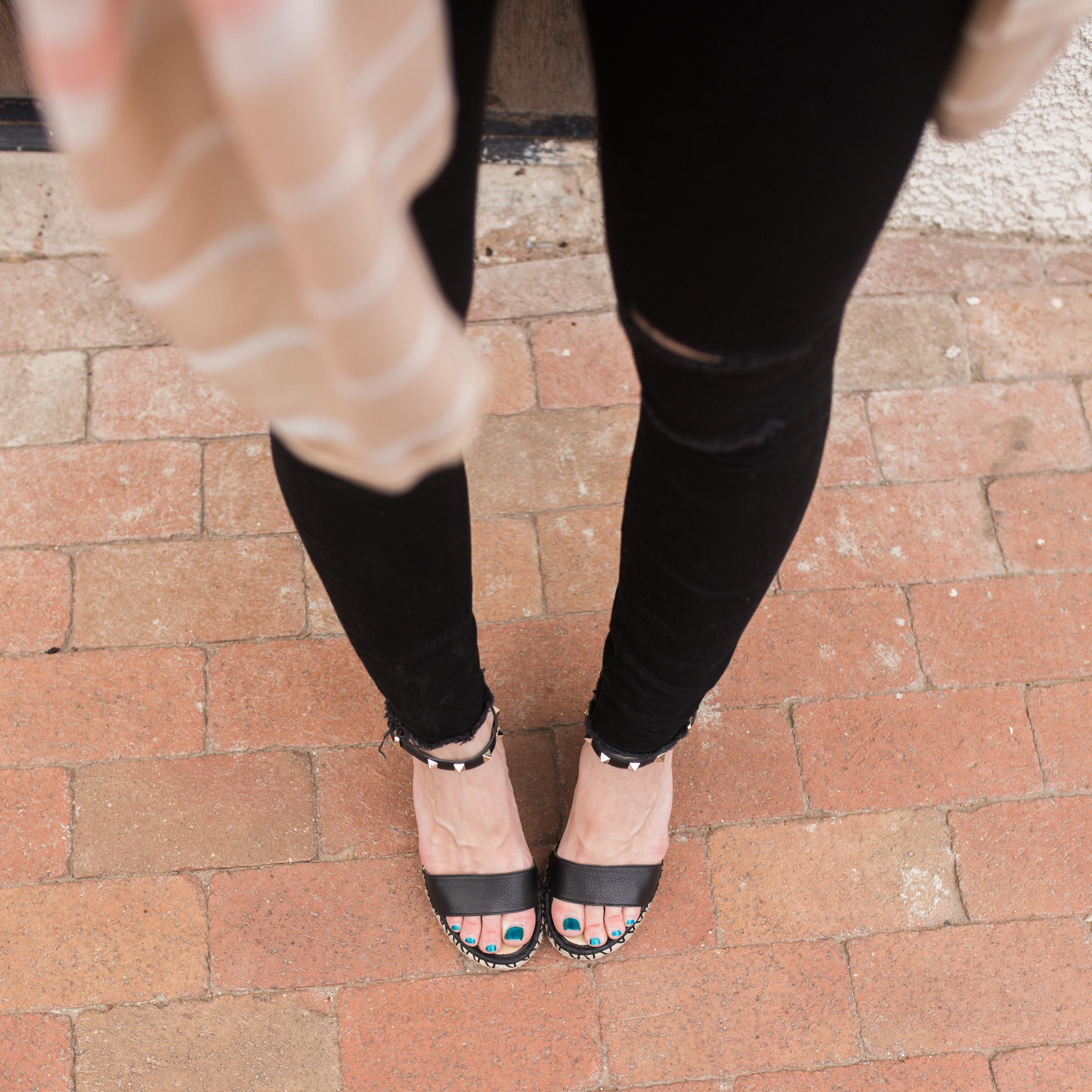black distressed jeans, black wedge sandals